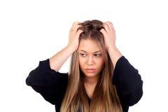 年轻白肤金发的女孩白色头疼 免版税库存图片