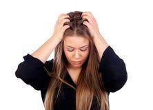 年轻白肤金发的女孩白色头疼 免版税库存照片