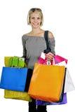白肤金发的女孩购物 免版税图库摄影