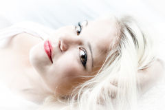 白肤金发的女孩头发 免版税库存图片