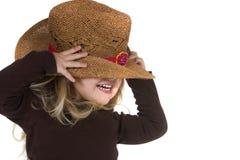 白肤金发的女牛仔女孩帽子 免版税库存图片