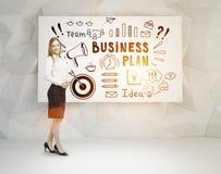 白肤金发的妇女和经营计划海报 免版税库存图片