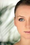 白肤金发的妇女的半面孔 免版税库存图片
