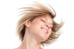 白肤金发的平直的发型 免版税库存图片