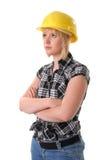 白肤金发的建筑女性安全帽工作者 免版税库存图片