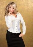 白肤金发的束腰性感的裙子妇女 库存照片