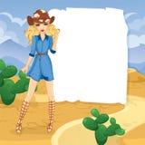 白肤金发的牛仔女孩在沙漠 免版税库存照片
