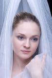白肤金发的特写镜头织品女孩纵向白&# 免版税库存照片