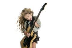 白肤金发的电女孩吉他使用的一点 库存照片