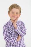 白肤金发的男孩画象有成人姿势的 库存图片