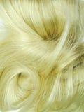 白肤金发的聚焦头发纹理背景 免版税库存图片