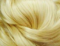 白肤金发的聚焦头发纹理背景 免版税库存照片
