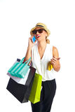 白肤金发的shopaholic妇女袋子和智能手机 免版税库存照片