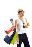 白肤金发的shopaholic妇女袋子和智能手机 库存照片