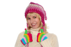 白肤金发盖帽女孩微笑 免版税图库摄影