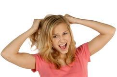 白肤金发青少年撕毁她的头发 免版税库存图片