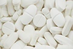 白色使药片服麻醉剂 免版税库存照片