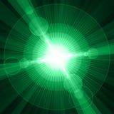 白色光亮的圈子和星绿色背景 免版税库存照片
