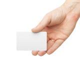 白色卡片在白色背景隔绝的一只人的手上 免版税库存图片
