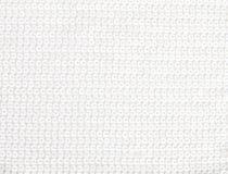 白色发光的衣服饰物之小金属片纺织品背景 图库摄影
