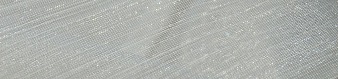 白色发光的衣服饰物之小金属片纺织品背景 免版税库存图片