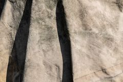 白色变老了在好光的肮脏的帆布表面纹理 库存图片