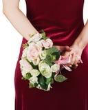 从白色和桃红色玫瑰的婚礼花束在新娘的手上 库存图片
