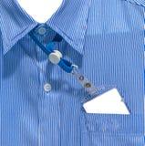 白色和蓝色排行了在办公室衬衣的样式设计 库存照片