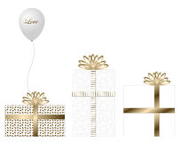 白色和金礼物 库存图片