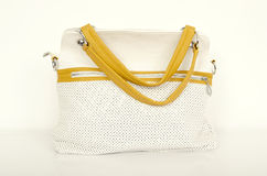 白色和黄色袋子 免版税库存照片