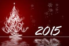 白色圣诞节树有红色背景2015年 库存照片