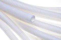 白色塑料波纹状的管子 库存照片
