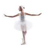 白色天鹅的逗人喜爱的小的芭蕾舞女演员跳舞角色 库存照片