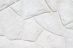 白色岩石墙壁背景 免版税库存照片