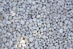 白色岩石小卵石背景 免版税库存图片