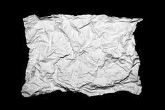 白色弄皱了在黑背景隔绝的纸 免版税库存照片