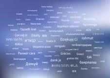 白色感谢词组用世界的不同的语言在蓝色背景的 皇族释放例证