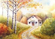 白色房子在秋天森林里 库存照片