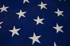 白色星特写镜头在美国国旗蓝色背景的  免版税库存图片