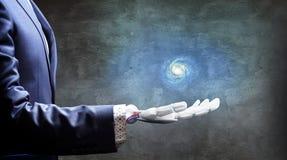 白色机器人手提出星系空间 3d翻译 免版税库存图片