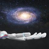 白色机器人手提出星系空间 3d翻译 库存照片