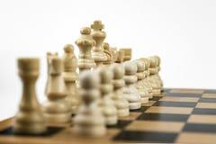 白色棋队,在国王的焦点 库存照片