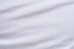 白色橄榄球球衣衣物织品纹理体育佩带 免版税库存图片