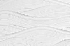 白色波浪膏药纹理 轻的现代抽象背景 库存照片