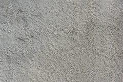 白色涂灰泥的和被绘的混凝土墙 库存照片