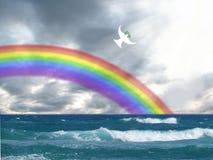 白色潜水飞行到与和平和圣灵的橄榄色的叶子和彩虹基督徒标志的光 库存图片