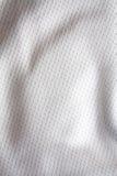 白色炫耀衣物织品球衣 免版税库存照片