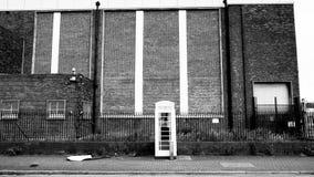 白色电话箱子和仓库 库存照片