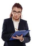 白色的可疑女实业家 免版税库存图片
