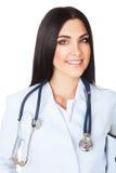 白色的美丽的微笑的医生与听诊器 库存图片